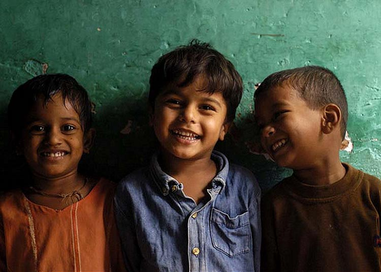 3 Indian children smiling playfully