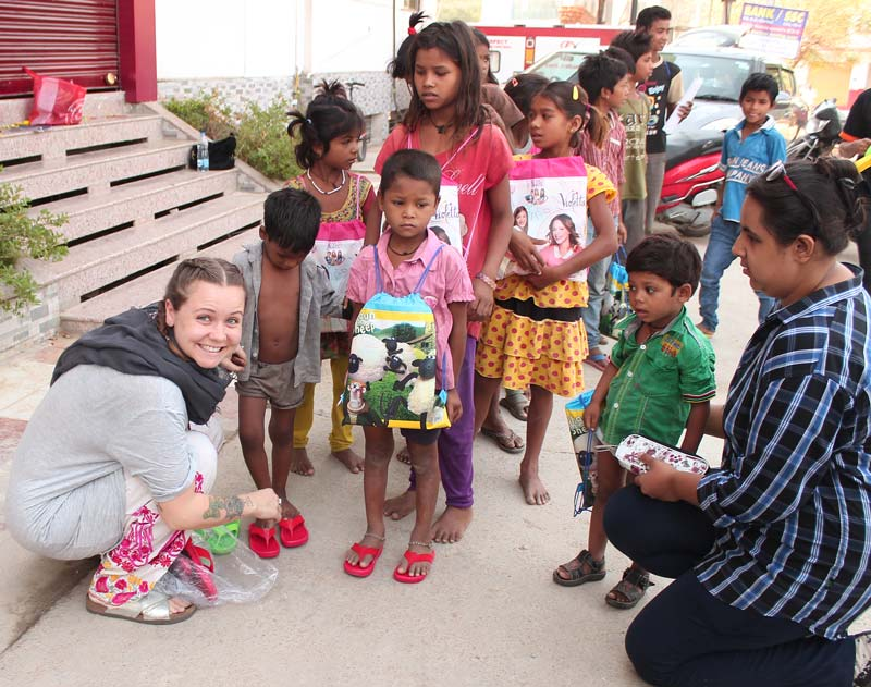 Bobbi with Gramiksha Kids and a Volunteer