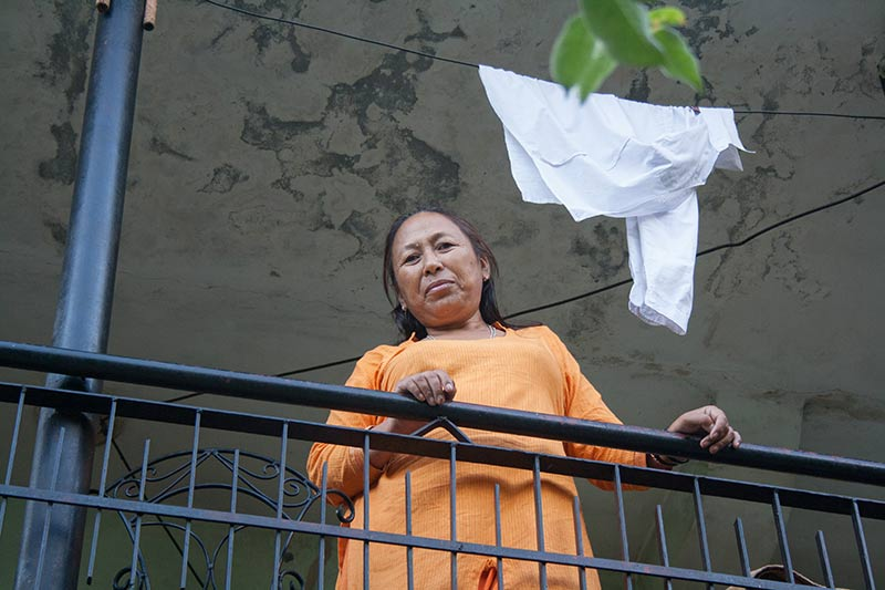 Sudeshna on a balcony